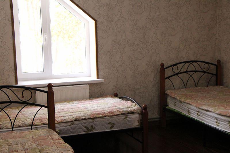 Трёхместный номер с односпальными кроватями
